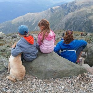kids with dog on mountain