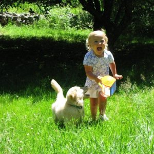 little girl running with puppy